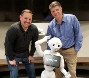 Doug Leidig (Asbury), Tom Mann (Love & Company) and Pepper the Robot. Pepper is one key example of new technology in senior living that can have a huge impact for providers.